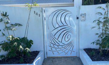 FENCING Awards nomination - Crashing waves entrance gate by Oceans Fencing